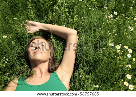 Young Woman resting on meadow. Summer relax - stock photo