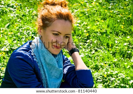 young woman resting on the grass