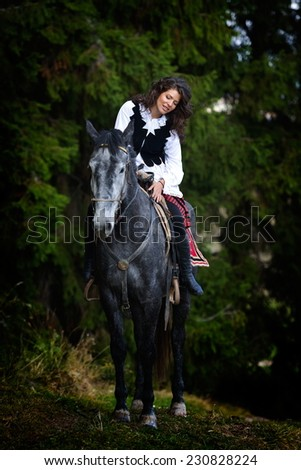 young woman riding horse outdoor - stock photo