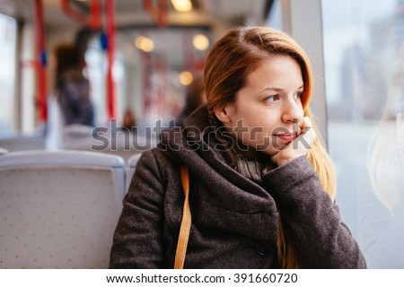 Young woman riding in public transport