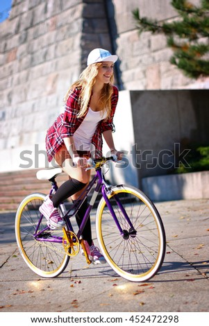 Young Woman Riding The Bicycle