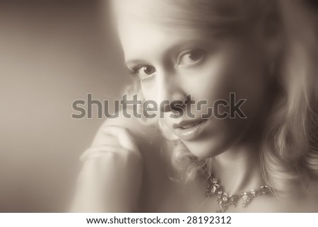Young woman romantic portrait. Special blur effect to add some haze. Sepia retro colors. - stock photo