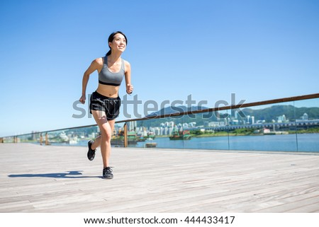 Young woman running at day time