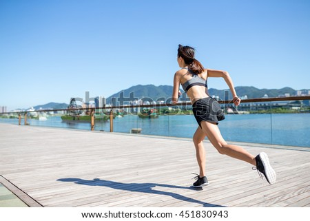 Young Woman running in city