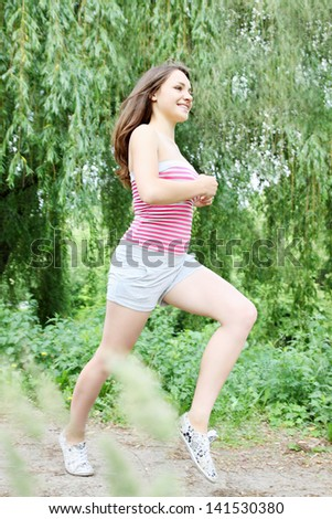 Young woman running in the park in the morning