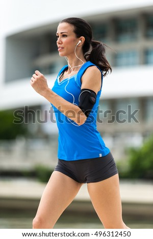 Young Woman Running Jogging in Urban Environment
