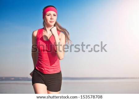 young woman running on the beach - stock photo