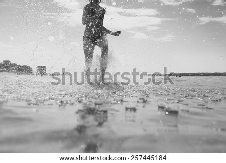 young woman running on the water - stock photo