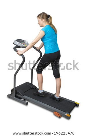 Young woman running on treadmill, isolated over white with clipping path. - stock photo