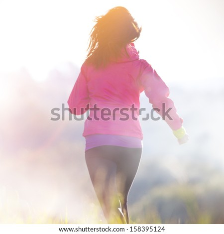 Young woman running outdoors - stock photo