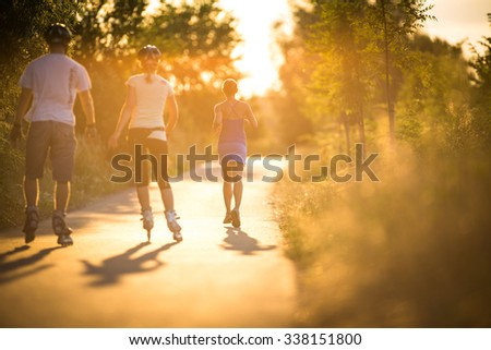 Young woman running outdoors in a city park - stock photo