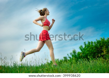 Young woman running summer park rural road. Outdoor exercises. J - stock photo
