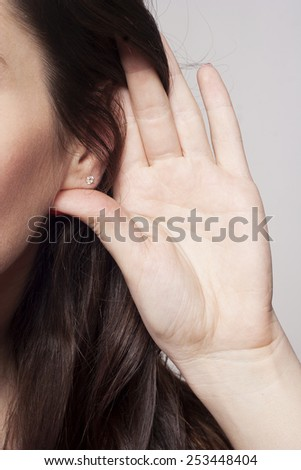 Young woman's ear close up - stock photo