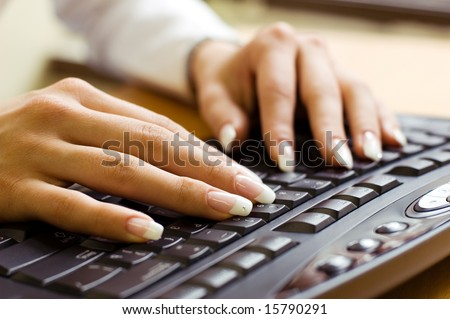young woman's hands on a keyboard