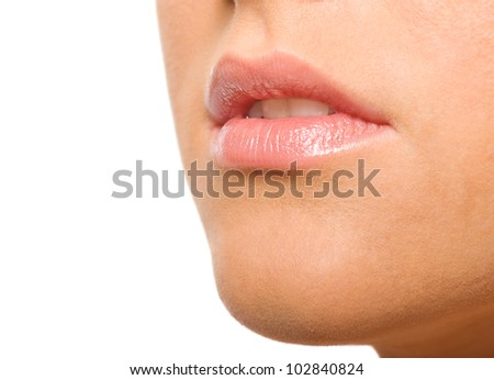Young woman's Lips close up isolated on white - stock photo