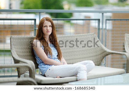Young woman's portrait outdoors at summer