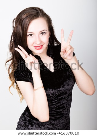 young woman's portrait with different happy emotions. girl making a victory sign hand - stock photo