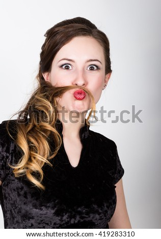 young woman's portrait with different happy emotions. she made from her hair himself mustache