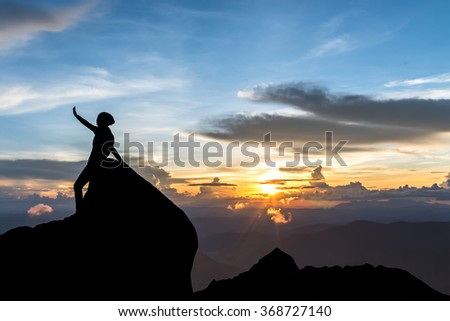 Young woman's silhouette at sunset - stock photo