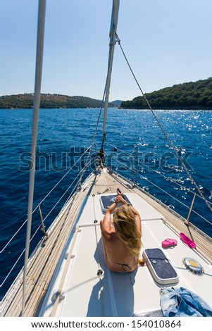 Young woman Sailing On Yacht