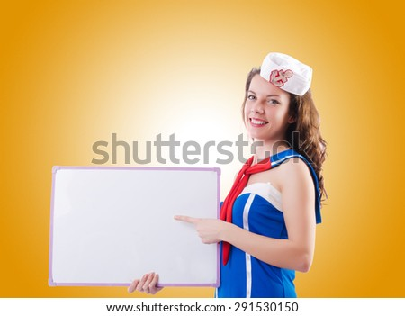 Young woman sailor in marine concept - stock photo