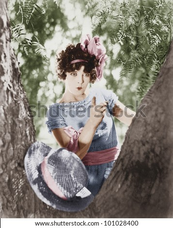 Young woman scolds a knotty tree - stock photo