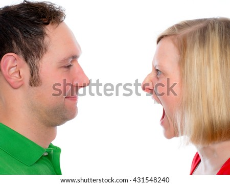 young woman scream at so her husband - stock photo