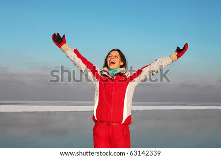 Young woman scream into cold winter sky