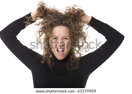 young woman screaming and pulling her hair