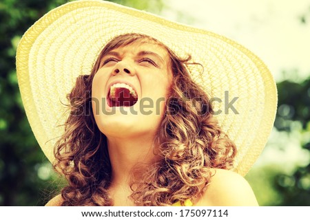 Young woman screaming in country side