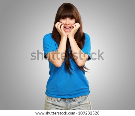 young woman screaming isolated on gray background