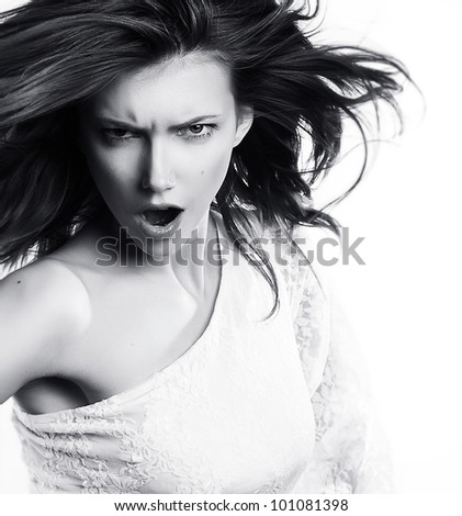 Young woman screaming on white background - black and white photo - stock photo