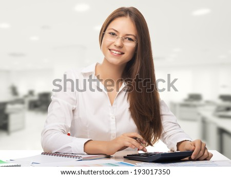 Young woman secretary at work at the office   - stock photo