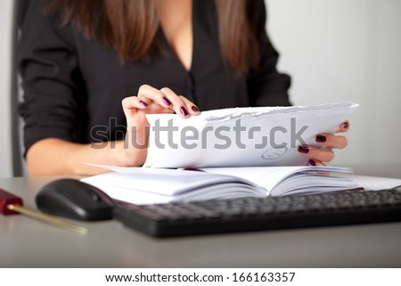 young woman secretary sort by size letters