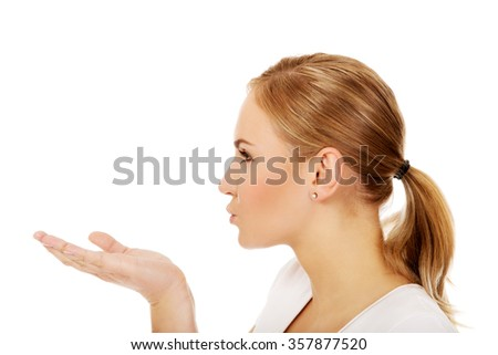 Young woman sending a kiss. - stock photo