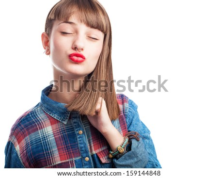 young woman sending a kiss isolated on white background