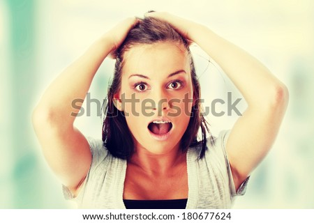 Young woman shocked.  - stock photo