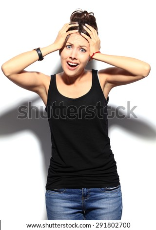 Young woman shocked - stock photo