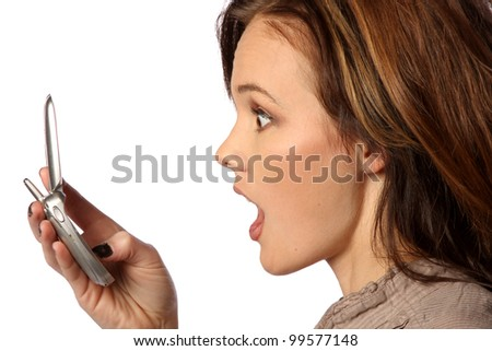 young woman shocked at something on her cell phone