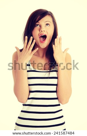 Young woman shocked close up portrait. - stock photo