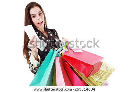 young woman shocking after checking over the receipt in her hands and spending too much - stock photo