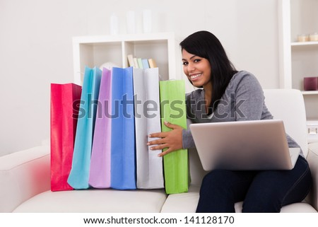 Young Woman Shopping Online With Shopping Bags - stock photo