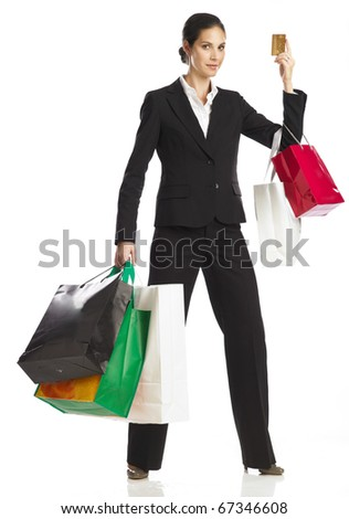 Young woman shopping with credit card - stock photo