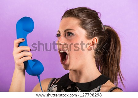 Young Woman Shouting Against Receiver - stock photo