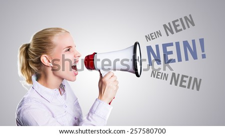 young woman shouting No! through a megaphone (in German) - stock photo