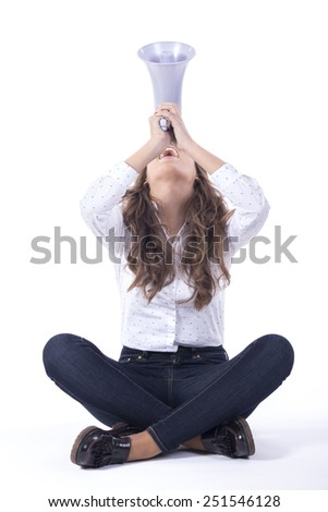 Young woman shouting with a megaphone over a white background - stock photo