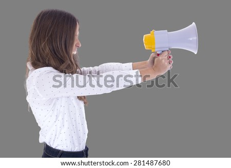 Young woman shouting with a megaphone over a white background