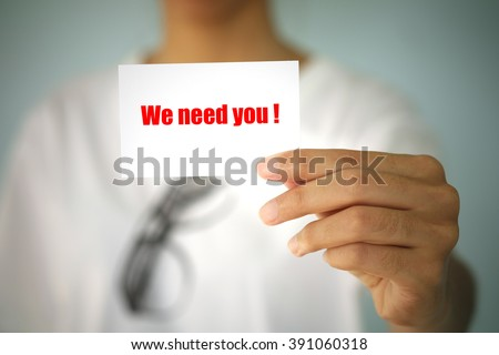 young woman show WE NEED YOU on card , business idea ,business concept ,business analysis - stock photo
