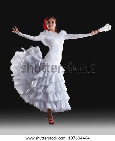 Young woman show white flamenco costume