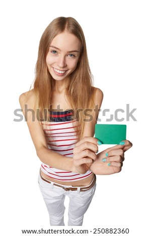 Young woman showing blank credit card. Happy smiling multi ethnic female model isolated in full length on white background in high angle view - stock photo